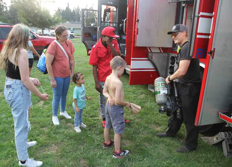 PMG PHOTO: JUSTIN MUCH - Checking it out: Aurora Fire with its rigs and apparatus provided a popular attraction to the community celebration Saturday, Aug. 14.