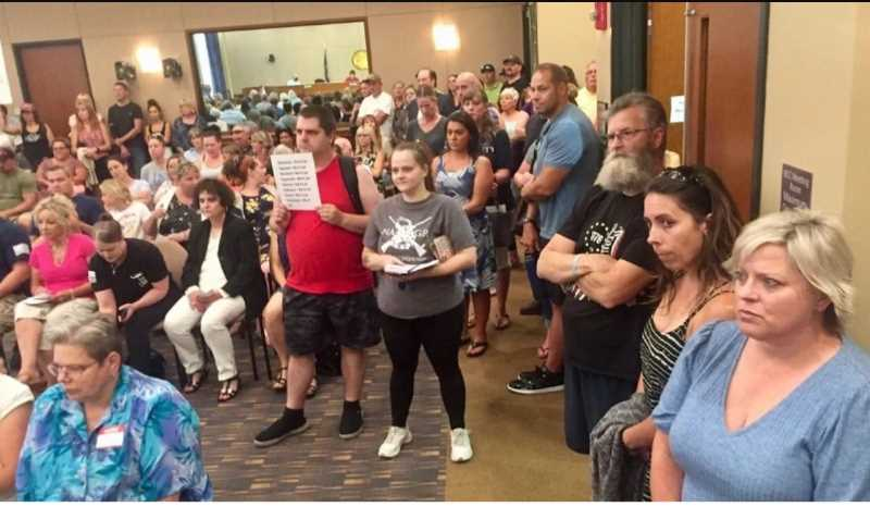 PHOTO COURTESY: KOIN 6 NEWS - Encouraged by the top elected leader in Clackamas County, hundreds of unmasked people packed the Aug. 12 commission meeting to protest the governor's latest indoor mask mandate.