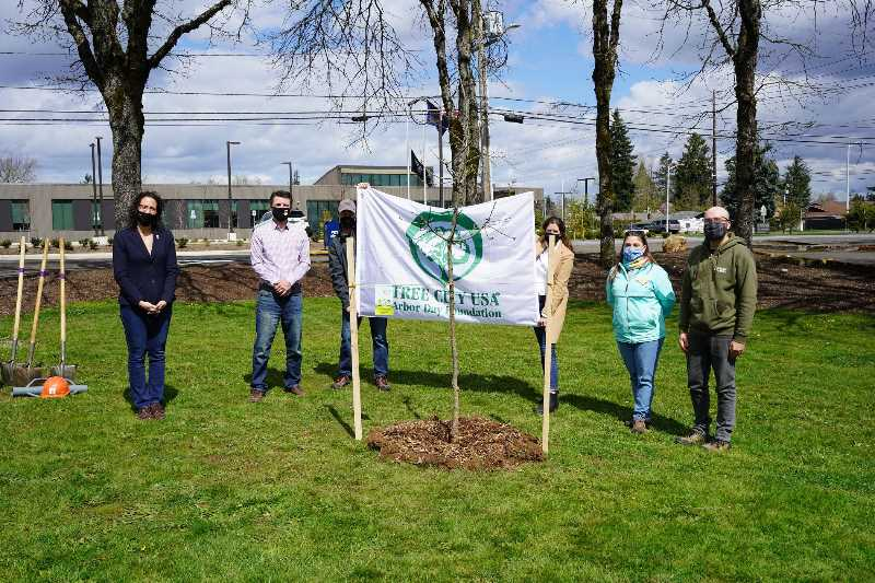 PHOTO COURTESY: CITY OF OC - Oregon City officials join Friends of Trees and Oregon Community Trees groups to plant a white oak at the city's Community Development Office in April.