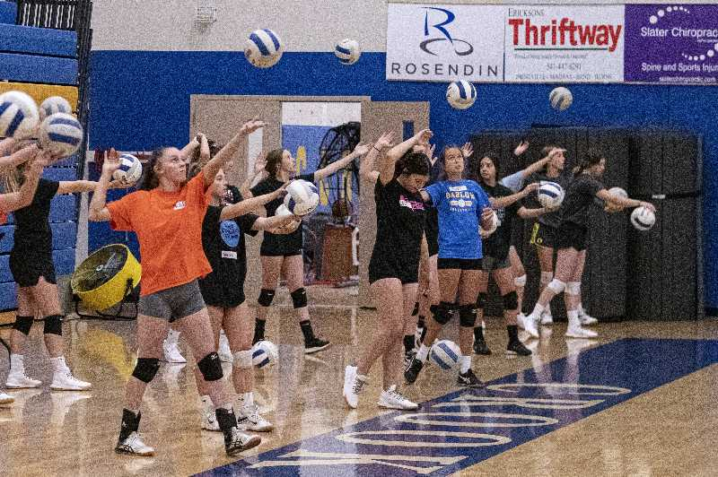 LON AUSTIN - Crook County volleyball players participate in serving drills during their opening day of fall practice Monday morning. Fall sports got underway this week, mostly with afternoon practices. The volleyball team, last year's Intermountain Conference regular season and tournament champions, open against Sisters on Aug. 31.