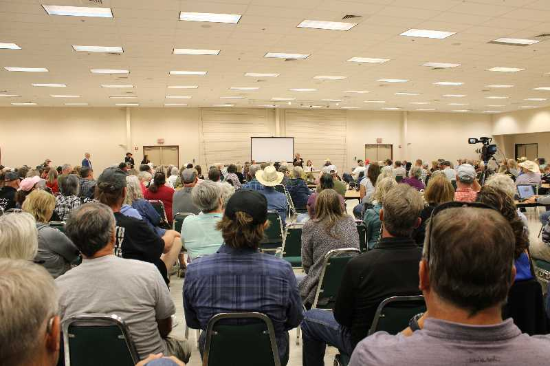 PAT KRUIS/MADRAS PIONEER - A panel of experts, lawyers, lobbyists and political activists, advise an room full of Central Oregon farmers, ranchers and the people who support them. The group crowded into the Sisters Building at the Deschutes County Fairgrounds Tuesday night, Aug. 17.