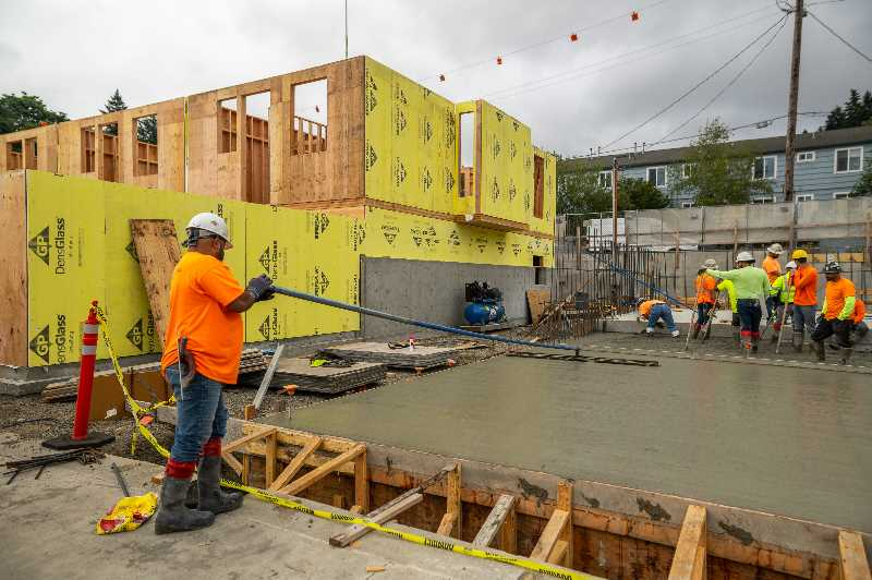 COURTESY PHOTO: NOEL JOHNSON - Workers lay the foundation at developer Noel Johnson's cross-laminated timber Wilson Forest Park Townhomes in Northwest Portland. Johnson said the permitting has taken three and a half years, for a building that takes just eight months to erect.