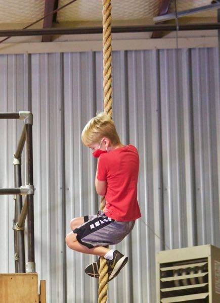 PMG PHOTO: CHRISTOPHER KEIZUR - Kids built strength and confidence during 16-year-old Caiden Madzelans summer camp.
