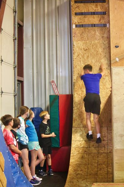 PMG PHOTO: CHRISTOPHER KEIZUR - Caiden Madzelan showed off the best way to take on the warped wall obstacle.