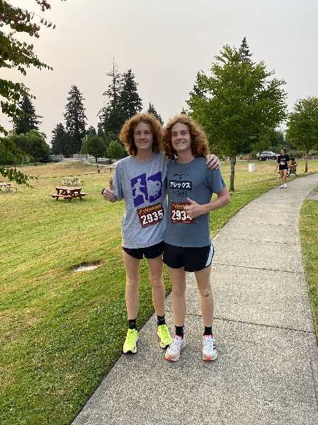 COURTESY PHOTO: DENNIS OLSTEDT - Luke and Rowen Suchoski took second and first place in the mens 6k race.
