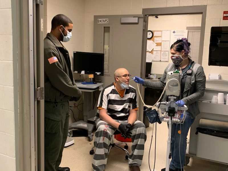 COURTESY PHOTO: CCSO - A Clackamas County Jail inmate gets a temperature reading from medical staff.