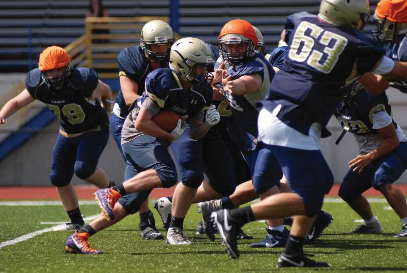 PMG FILE PHOTO - The Canby High football team has plenty of talent, good numbers and a reemerging culture of hard work and committment heading into its 2021 fall campaign.