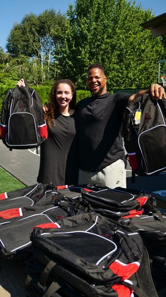 COURTESY PHOTO - Ndamukong Suh, a star NFL defensive lineman from Portland, and wife Katya have given away backpacks and financial lessons through their foundation, Suh Family Foundation. They want to each young people about money, along with another Portland NFL player, Brennan Scarlett.