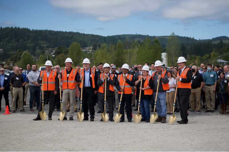 PMG PHOTO: ANNA DEL SAVIO - Business, educational and political leaders who have supported OMIC stand in front of attendees at a groundbreaking ceremony on Aug. 19, 2021.