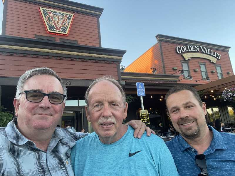 PHOTO COURTESY: TIM WAUD - Tim Waud, Jim Teisher and Aaron Hawkins pose for a photo after celebrating Teisher's survival of a near drowning in an Oregon City river in June 2020.