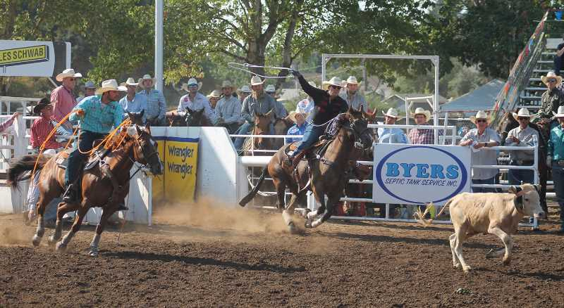 PMG PHOTO: JOHN BAKER - The action was fast and furious as rodeo athletes competed for more than $171,000 in prize money during this year's Canby Rodeo.