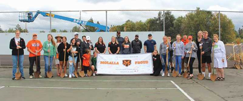 PMG PHOTO: SANDY STOREY - A gathering Sunday afternoon at the Molalla High School tennis courts that are set for a complete recvamping.