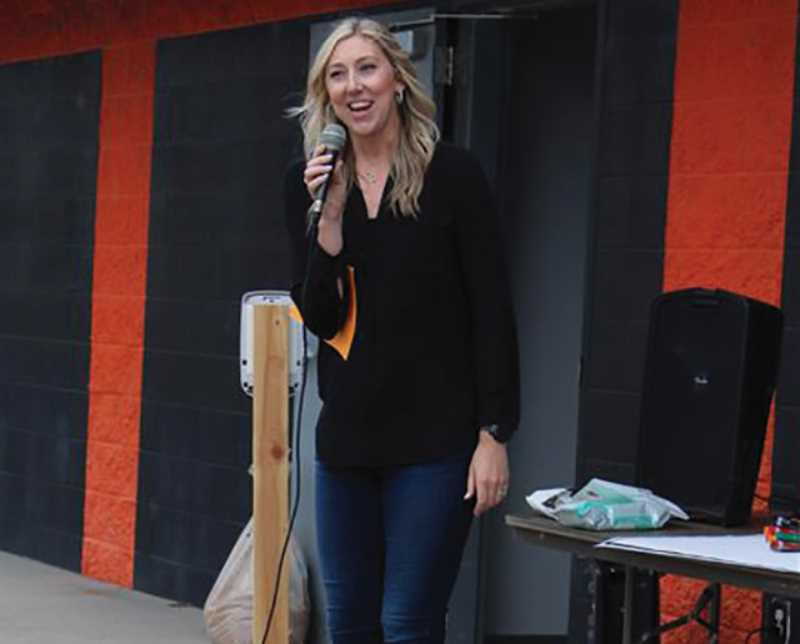 PMG PHOTO: SANDY STOREY - Molalla High School Athletic Director Kristen Rott offers a few words about how the tennis court reconditioning came about and who contributed to it during Sunday's groundbreaking event.