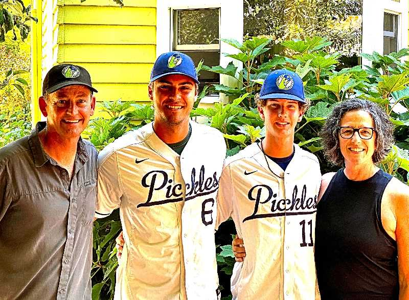 PAIGE WALLACE - Jay Mellies and Ellen Damaschino pose outside their Eastmoreland home with the two Portland Pickles baseball players they hosted this season, Jacob Jablonski and Justin DeCriscio.