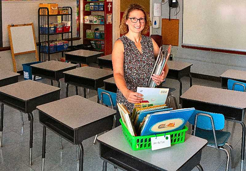DAVID F. ASHTON - Second Grade Teacher Mary Burtram was busy preparing her classroom at Holy Family Catholic School. The room was empty then, but it will be full of kids after Labor Day.