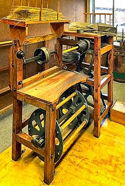 COURTESY OF HANSET BROTHERS - This is an old kicker pedal broom machine that Emil Hanset would have used, before the Hanset Brothers replaced it with an electrically-powered broom-making machine.