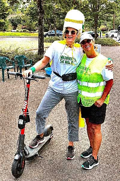 DAVID F. ASHTON - Before scooting off to lead another group, Warrior 5K Walk Grand Marshal Amanda Valley spent a moment with organizer Kristin Cole, at the rally spot.