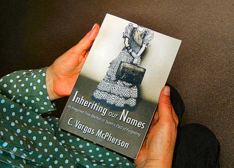 ELIZABETH USSHER GROFF - In the narthex of All Saints Episcopal Church in the Woodstock neighborhood, the local resident known as C. Vargas McPherson holds her book - published to rave reviews in April of this year.