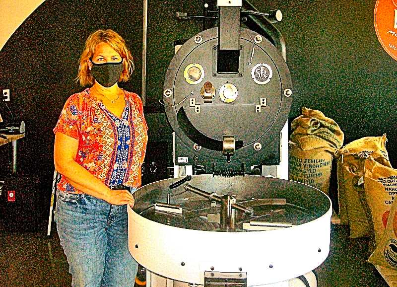 RITA A. LEONARD - Fetch owner and coffee roaster Sarah Witter, standing by her roaster - adjacent to the new coffee shops indoor seating area.