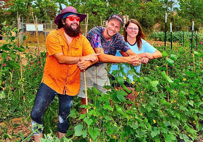 DAVID F. ASHTON - Ready for another weekly harvest in Brentwood-Darlington, here are Harvest Share gardeners Zeke Zager, Eric Benedon, and Liv Carmody.