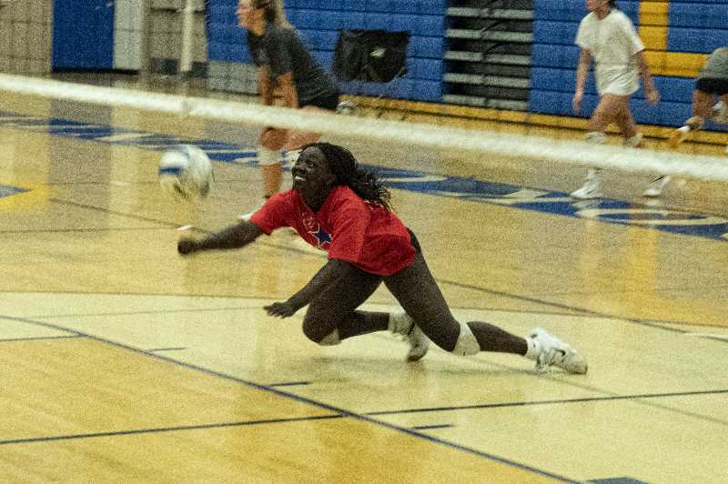 LON AUSTIN - Joann McKinnon dives to keep a ball in play during a recent Cowgirl volleyball practice. Playing tough defense is something Crook County is becoming known for. Crook County has won a trophy at the state tournament in 14 of the last 15 years.