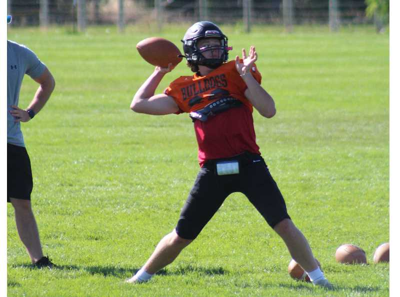 ANDY DIECKHOFF/MADRAS PIONEER - Junior quarterback Logan Macy takes over as the new signal-caller in Brian Silbernagel's offense.