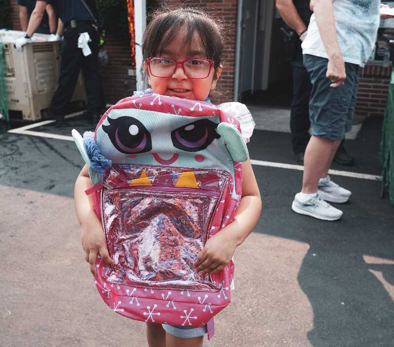 COURTESY PHOTO - More than 400 backpacks were given out during the recent Canby Center event.