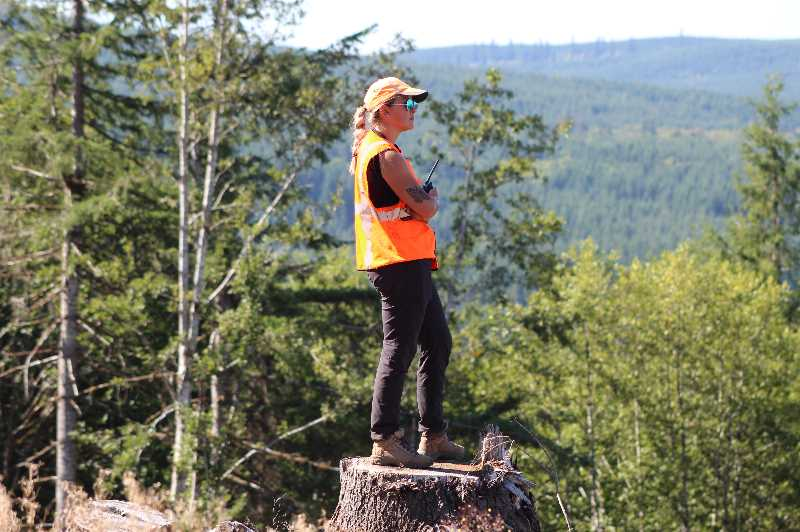 COURTESY PHOTO: DRONESEED - A DroneSeed pilot watches a drone scanning a hillside with LIDAR. The company recently bought a seed company Silvaseed so it would have better access to plantings and speed up the reforestation process.