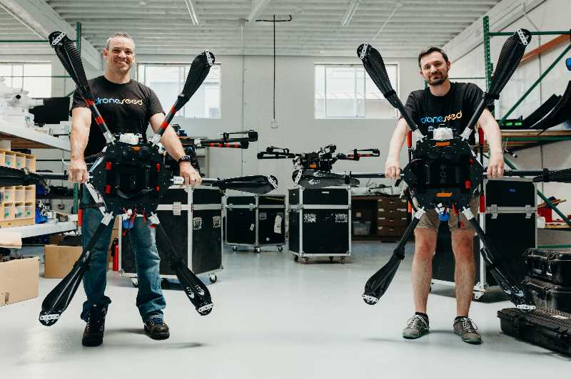 """COURTESY PHOTO: DRONESEED - DroneSeed's Wilsonville-born and bred founder and CEO Grant Canary (left) told the Business Tribune they purchased the 130-year-old company because of """"skyrocketing demand for reforestation' due to wildfires."""