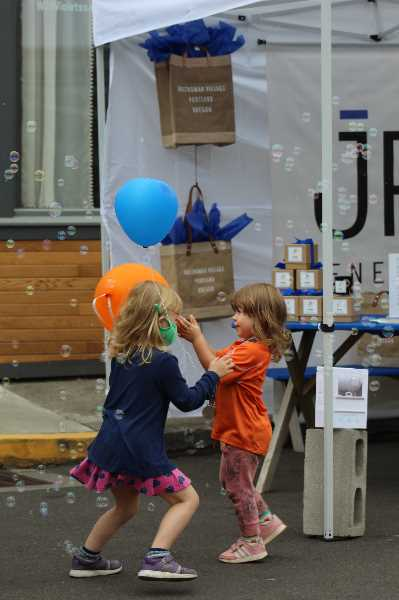 PMG PHOTO: COURTNEY VAUGHN - Children play in front of a bubble machine Saturday, Aug. 21 during Multnomah Days.