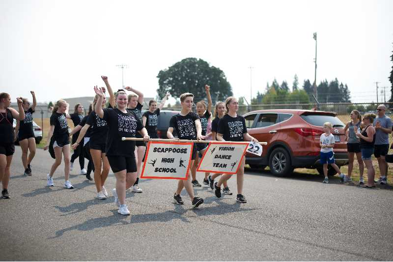 PMG PHOTO: ANNA DEL SAVIO - Vision dancers walk in the parade at the Scappoose Centennial.