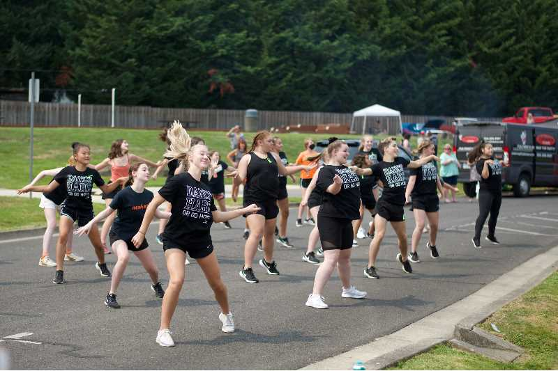 PMG PHOTO: ANNA DEL SAVIO - The Scappoose High School dance team performs at the opening ceremony of the Scappoose Centennial on Saturday, Aug. 14.
