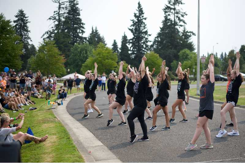 PMG PHOTO: ANNA DEL SAVIO - Scappoose Vision dancers perform an energetic dance at the citys centennial celebration.