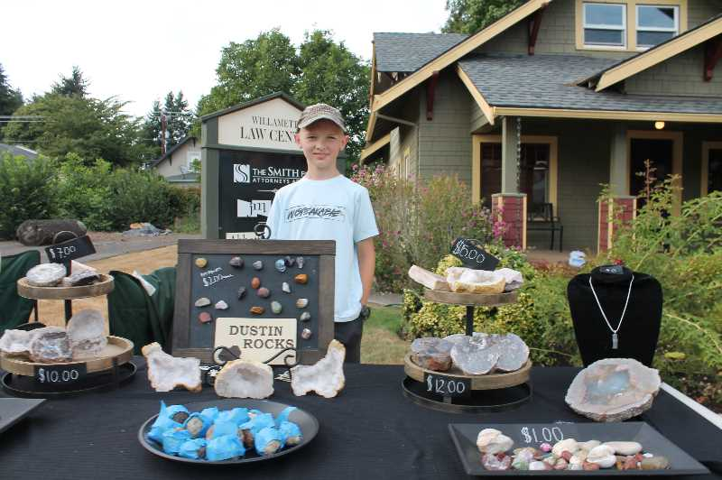 PMG PHOTO: HOLLY BARTHOLOMEW - Dustin Peterson, 11, sells geodes, agates and other rocks at the West Linn Summer Market