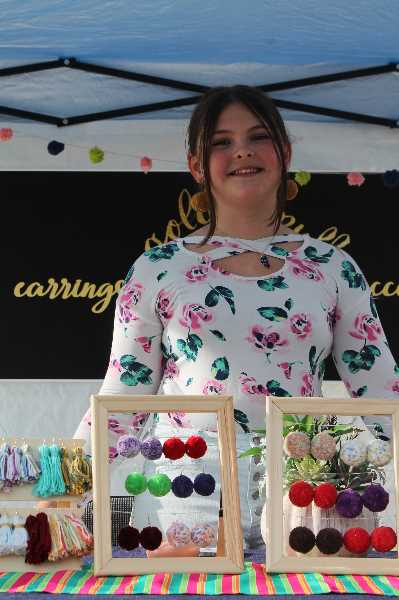 PMG PHOTO: HOLLY BARTHOLOMEW - Leah Jansen, 11, sold her handmade jewelry at the West Linn Summer Market.