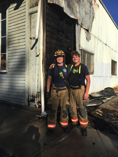 COURTESY PHOTO - Jared Redmon (left) and Noah Wierstra helped extinguish a fire at a food bank in Woodburn.