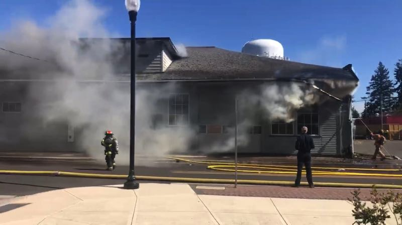 COURTESY PHOTO - Firefighters respond to the fire at the Woodburn food bank.