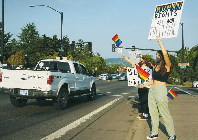 PMG PHOTO: GARY ALLEN - Nearly 200 people gathered at the flag pole on First Street on Aug. 24 to protest a recent decision by the Newberg school board and to support the display of Black Lives Matter and Pride flags in the schools.