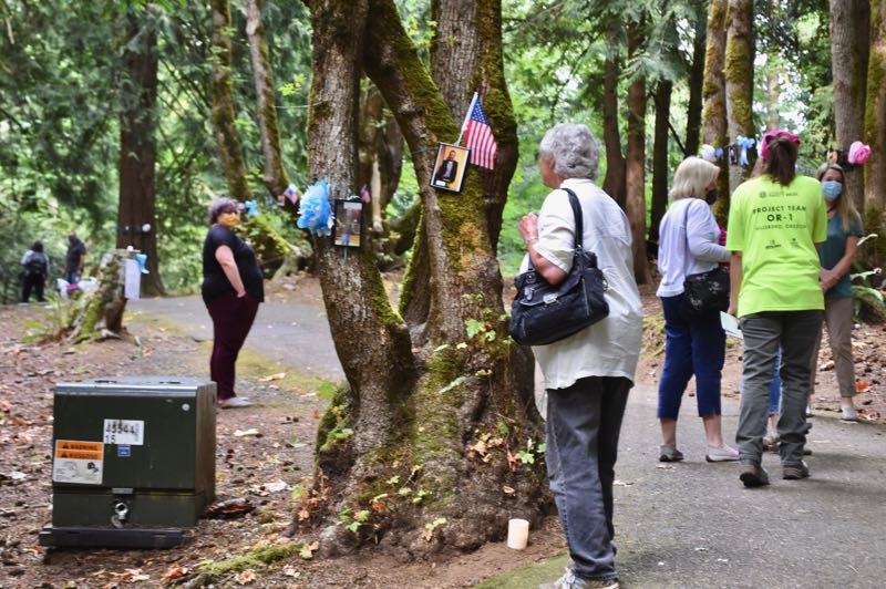 PMG PHOTO: BRITTANY ALLEN - More than 50 people attended the Time of Remembering on Aug. 25 in Meinig Memorial Park.
