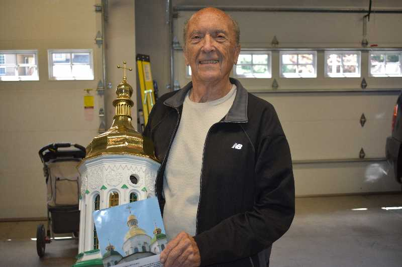 PMG PHOTO: ANGEL ROSAS  - Marty Smith holding his birdhouse replica of the Saint Sophia Cathedral in Kyiv, Ukraine.