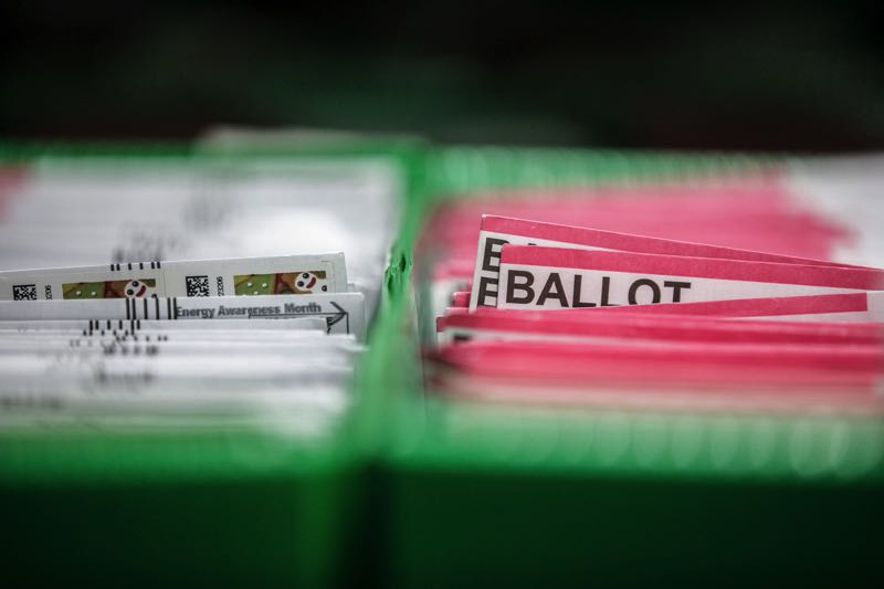 FILE - Ballots wait to be counted at the Multnomah County Elections office in 2020.