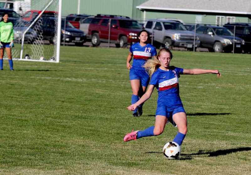 MADRAS PIONEER FILE PHOTO - Senior midfielder Brooke Delamarter, right, is one of the top returning players on the MHS girls' soccer team.