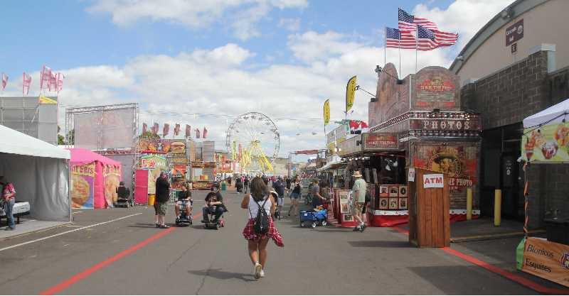 PMG PHOTO: JUSTIN MUCH - The 157th Oregon State Fair featured all the staples: food, exhibits, rides and one outlier -- a vaccination clinic.