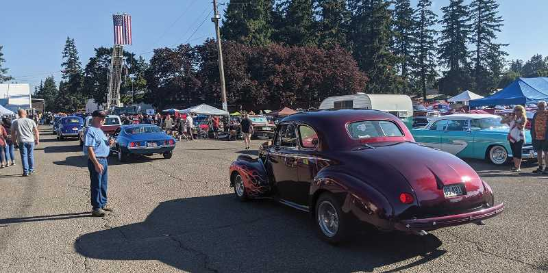 PMG PHOTO: JOHN BAKER - Classic cars stream into the fairgrounds early Saturday at the Cutsforth's Cruise-In got underway with hundreds of cars to check out.
