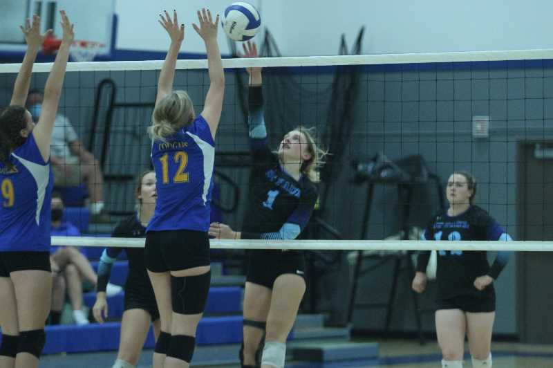 PMG PHOTO: TANNER RUSS - St. Paul junior Anabelle Davidson tries get the ball past the Gervais blockers.