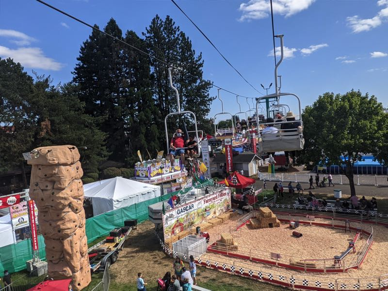 PMG PHOTO: JOSEPH GALLIVAN - A ride on the $5 FairLift provides cool views at Oregon State Fairgrounds.