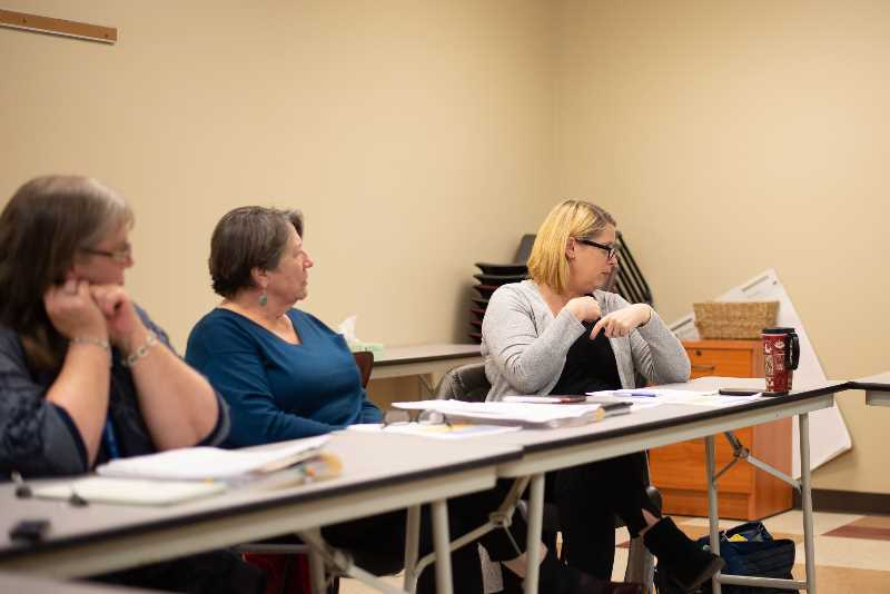 PMG PHOTO: ANNA DEL SAVIO - Columbia County Commissioner Margaret Magruder, center, and county counsel Sarah Hanson, right, attend a meeting in January 2020.