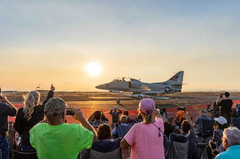 PHOTO BY JASON BLACKMAN  - The Douglas TA-4 Skyhawk jet, piloted by Jerod Flohr, taxies before an appreciative audience at the Airshow of the Cascades Friday night. After the pandemic canceled the 2020 show, airshow fans were eager to return to the Madras Municipal Airport for the Friday-Saturday event.