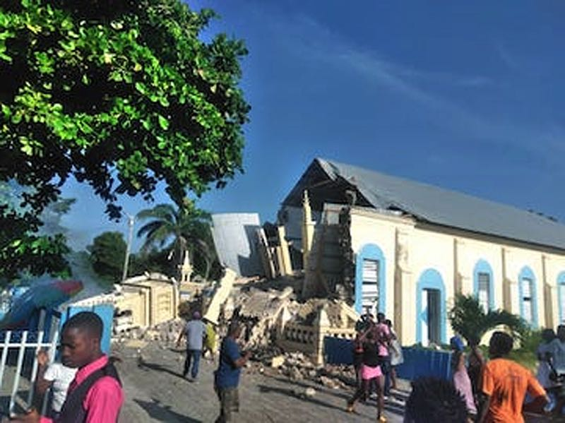 COURTESY PHOTO: JIM SHAW - The steeple of a Catholic church in Les Anglais collapses during a recent earthquake in Haiti.