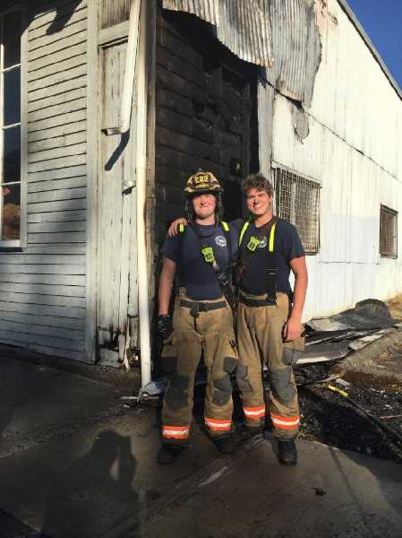 COURTESY PHOTO: WOODBURN FIRE DISTRICT - Student Resident Volunteer Firefighters Jared Redman (left) and Noah Wierstra.